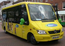The minibus with balloons on at a promotion event