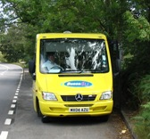 The minibus parked in a layby to pick up a passenger